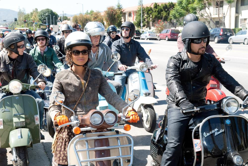 LARRY CROWNE, from left: Gugu Mbatha-Raw, Wilmer Valderrama, 2011. ©Universal Pictures