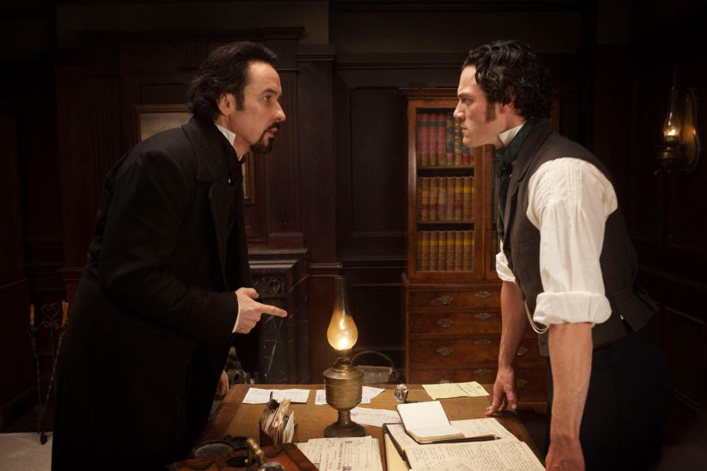 THE RAVEN, from left: John Cusack, as Edgar Allan Poe, Luke Evans, 2012. Ph: Larry Horricks/©Rogue Pictures