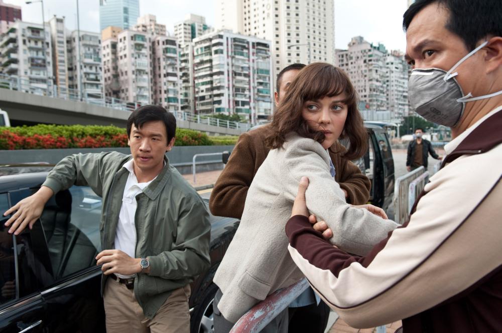 CONTAGION, Chin Han (left), Marion Cotillard (center), 2011. ph: Claudette Barius/©Warner Bros