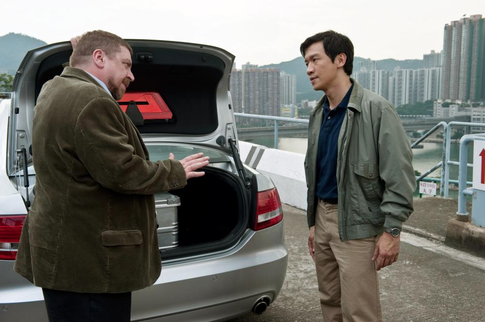 CONTAGION, from left: Armin Rohde, Chin Han, 2011. ph: Claudette Barius/©Warner Bros