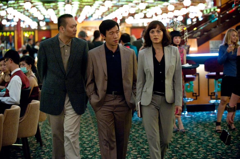 CONTAGION, Chin Han (center), Marion Cotillard (right), 2011. ph: Claudette Barius/©Warner Bros