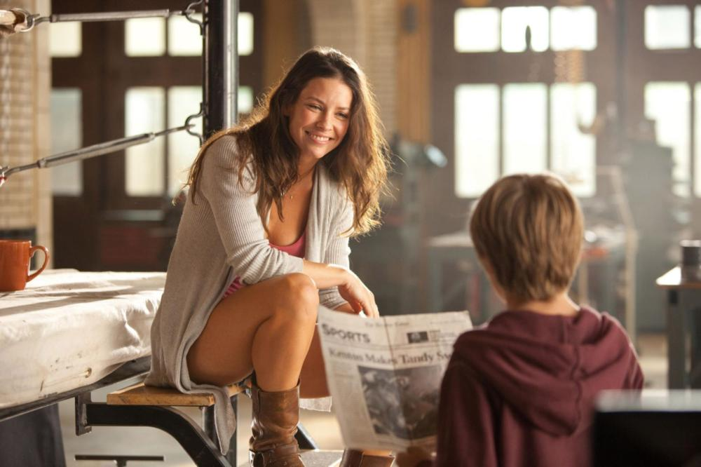 """REAL STEEL""  RS-08967  Bailey Tallet (Evangeline Lilly) tells Max (Dakota Goyo) that, as a boxer, his father, Charlie Kenton, was the top contender, number 2 in the world in DreamWorks Pictures' action drama ""Real Steel"".  Ph: Melissa Moseley  ©DreamWorks"