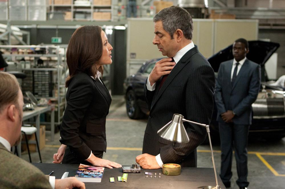 JOHNNY ENGLISH REBORN, Gillian Anderson, Rowan Atkinson, Daniel Kaluuya (back right), 2011, ph: Giles Keyte/©Universal Pictures