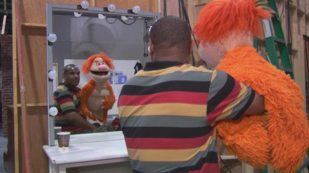 BEING ELMO: A PUPPETEER'S JOURNEY, Kevin Clash on set of 'The Game' with puppet 'Mookie', 2011, ©Submarine Entertainment