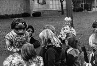 BEING ELMO: A PUPPETEER'S JOURNEY, Kevin Clash (left) circa 1975 in his hometown of Baltimore, MD performing for kids, 2011, ©Submarine Entertainment