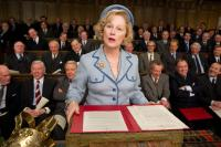 THE IRON LADY, foreground: Meryl Streep as Margaret Thatcher, 1st row from left: Nick Dunning (striped tie), John Sessions, Stephen Boxer, Peter Pacey, Julian Wadham, 2nd row, to the right of Streep: Angus Wright (glasses), Richard E. Grant (high forehead)