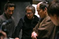 HARA-KIRI: DEATH OF A SAMURAI, (aka ICHIMEI), from left on set: Ebizo Ichikawa, director Takashi Miike, Koji Yakusho, 2011. ©Shochiku Company