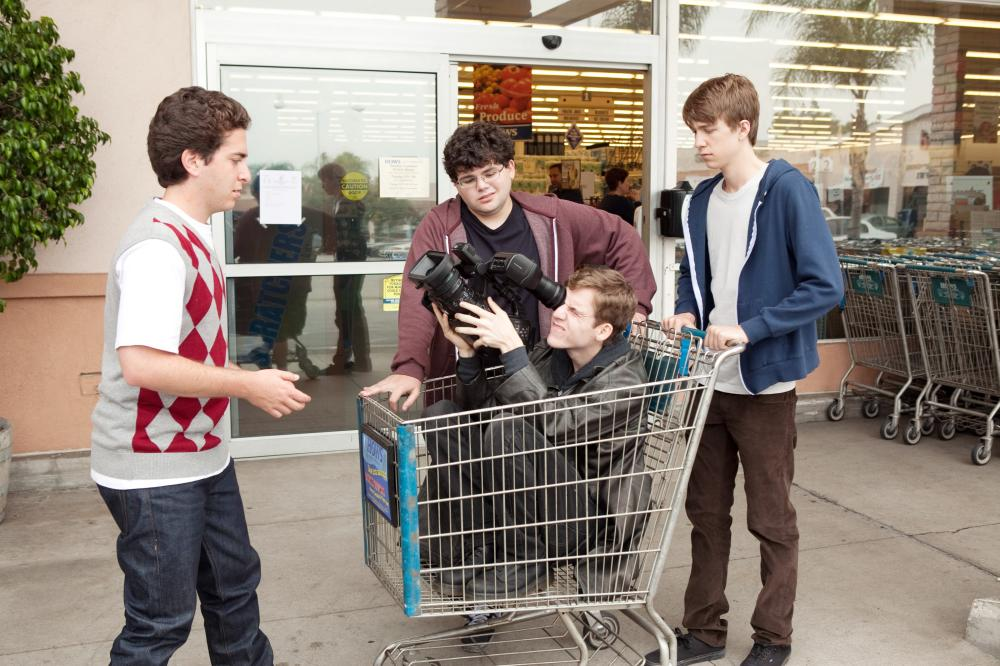 PROJECT X, from left: Oliver Cooper, Jonathan Daniel Brown, Dax Flame (in shopping cart), Thomas Mann, 2012. ph: Beth Dubber/©Warner Bros.