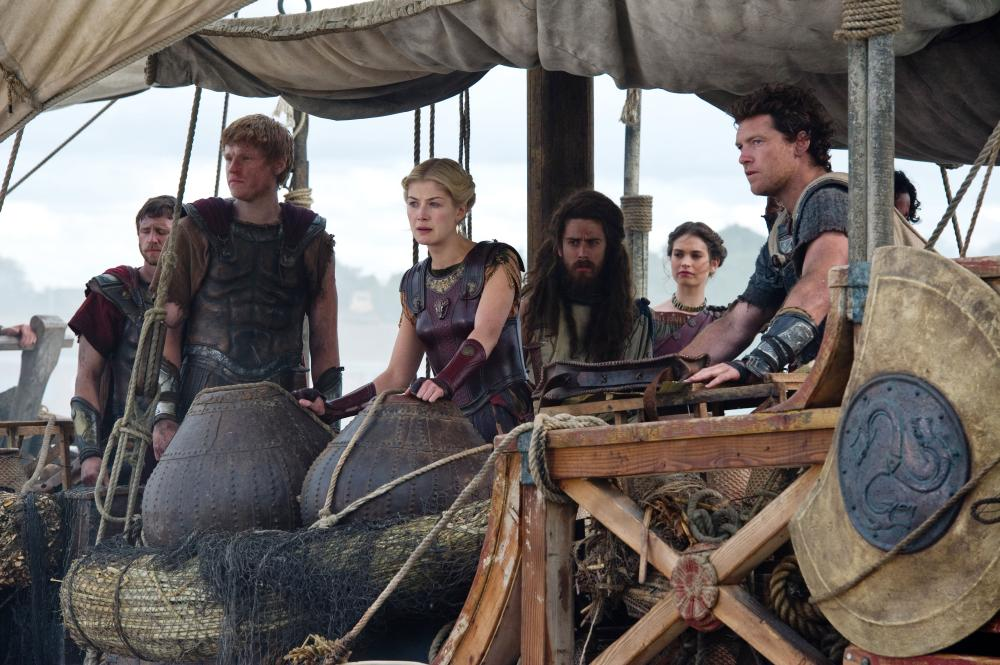 WRATH OF THE TITANS, Rosamund Pike (center), Toby Kebbell (long hair), Lily James (back right), Sam Worthington (right), 2012. ph: Jay Maidment/©Warner Bros. Pictures.