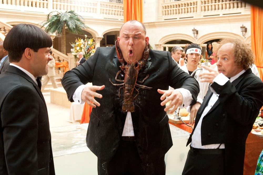 THE THREE STOOGES, from left: Chris Diamantopoulos as Moe, Will Sasso as Curly, Sean Hayes as Larry, 2012. ph: Peter Iovino/TM & copyright ©20th Century Fox Film Corp. All rights reserved
