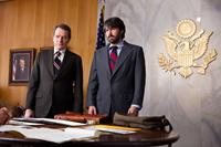 ARGO, from left: Jimmy Carter (in photograph), Bryan Cranston, Ben Affleck, 2012. ph: Claire Folger/©Warner Bros.