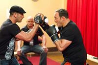 HERE COMES THE BOOM, l-r: Mark Dellagrotte, Bas Rutten, Kevin James, 2012, ph: Tracy Bennett/©Sony Pictures