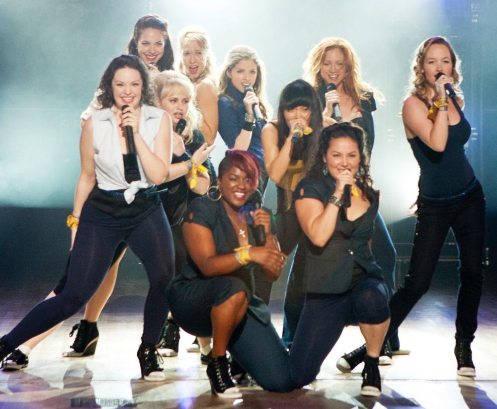 PITCH PERFECT, Hana Mae Lee (center, black hair), Alexis Knapp (back left), Rebel Wilson (blonde, left), Ester Dean (front, pink hair), Anna Kendrick (back, center), Brittany Snow (back, second from left), Anna Camp (right), 2012. ph: Peter Iovino/©Univers