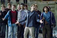 PITCH PERFECT, Adam DeVine (red shirt), Utkarsh Ambudkar (left of center), Skylar Astin (hands out), Michael Viruet (right), 2012. ph: Peter Iovino/©Universal Pictures