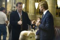 "Christopher Nolan and Aaron Eckhart on the set of ""The Dark Knight"""