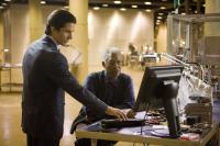"Christian Bale and Morgan Freeman in ""The Dark Knight"""