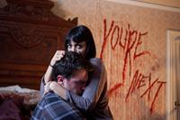YOU'RE NEXT, from left: Nicholas Tucci, Wendy Glenn, 2011. ph: Taylor Glascock/©Lionsgate