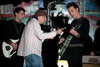 NOT FADE AWAY, from left: Will Brill, producer Steve Van Zandt, Jack Huston, on set, 2012. ph: Barry Wetcher/©Paramount Vantage