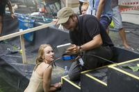 THE IMPOSSIBLE, l-r: Naomi Watts, director Juan Antonio Bayona on set, 2012, ©Summit Entertainment