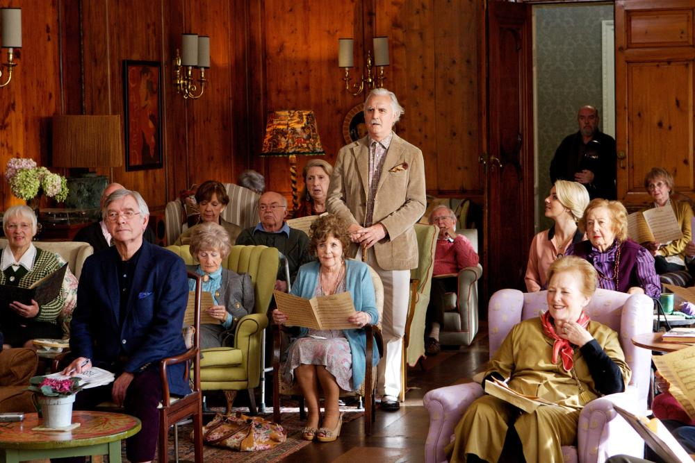 QUARTET, seated front left: Tom Courtenay, seated second center: Pauline Collins, standing: Billy Connolly, rear seated: Sheridan Smith, 2012, ph: Kerry Brown/©Weinstein Company