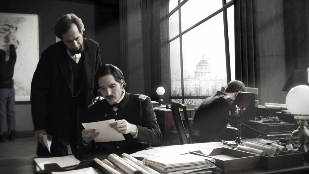 SAVING LINCOLN, from left: Tom Amandes, as Abraham Lincoln, David Dastmalchian, 2012.