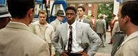 42, (aka FORTY-TWO), Lucas Black (left), Chadwick Boseman as Jackie Robinson (right of center of frame), Hamish Linklater (right of center), 2013./©Warner Bros. Pictures