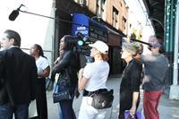 VENUS AND SERENA, Venus Williams (left of center), director Michelle Major (back center), on set, 2012. ©Magnolia Pictures