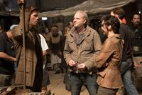 THE HUNGER GAMES: CATCHING FIRE, from left: Liam Hemsworth, director Francis Lawrence, Jennifer Lawrence, on set, 2013. ph: Murray Close/©Lionsgate