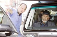 NOW YOU SEE ME, from left: director Louis Leterrier, Morgan Freeman, on set, 2013. ph: Barry Wetcher/©Summit Entertainment