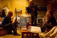 WORLD WAR Z, from left: Brad Pitt, director Marc Forster, Mireille Enos, on set, 2013. ph: Jaap Buitendijk/©Paramount Pictures