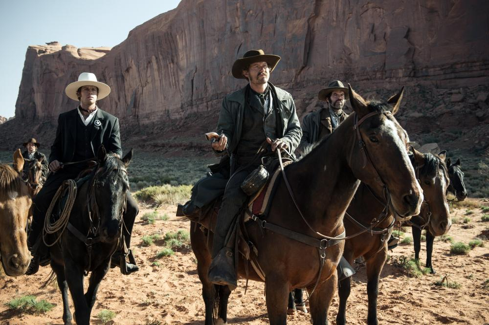 THE LONE RANGER, Armie Hammer (left), James Badge Dale (center), 2013./©Walt Disney Pictures