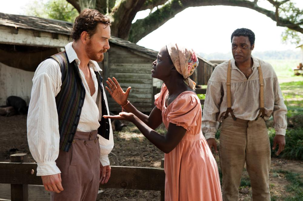 12 YEARS A SLAVE, from left: Michael Fassbender, Lupita Nyong'o, Chiwetel Ejiofor, 2013. ph: Francois Duhamel/TM and copyright ©Fox Searchlight Pictures. All rights reserved.