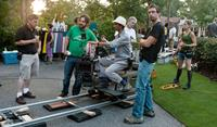 THE SPECTACULAR NOW, director James Ponsoldt (left, green shirt), cinematographer Jess Hall (sitting), on set, 2013. ©A24