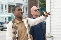 """(L-r) TRACY MORGAN as Paul and BRUCE WILLIS as Jimmy in Warner Bros. Pictures crime comedy """"Cop Out"""". PHOTOGRAPHS TO BE USED SOLELY FOR ADVERTISING, PROMOTION, PUBLICITY OR REVIEWS OF THIS SPECIFIC MOTION PICTURE AND TO REMAIN THE PROPERTY OF THE STUDIO. N"""