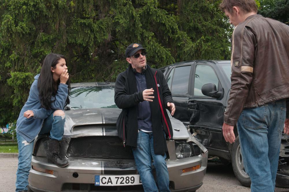 GETAWAY, from left: Selena Gomez, director Courtney Solomon, Ethan Hawke, on set, 2013. ph: Simon Varsano/©Warner Bros. Pictures
