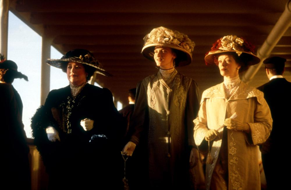 TITANIC, Kathy Bates, Kate Winslet, Frances Fisher, 1997, ship's deck.  TM and Copyright (c) 20th Century Fox Film Corp. All rights reserved..