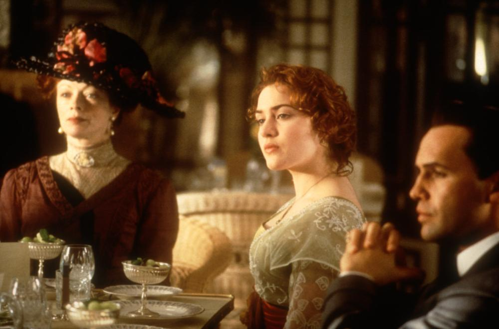TITANIC, Frances Fisher, Kate Winslet, Billy Zane, 1997, table.  TM and Copyright (c) 20th Century Fox Film Corp. All rights reserved..