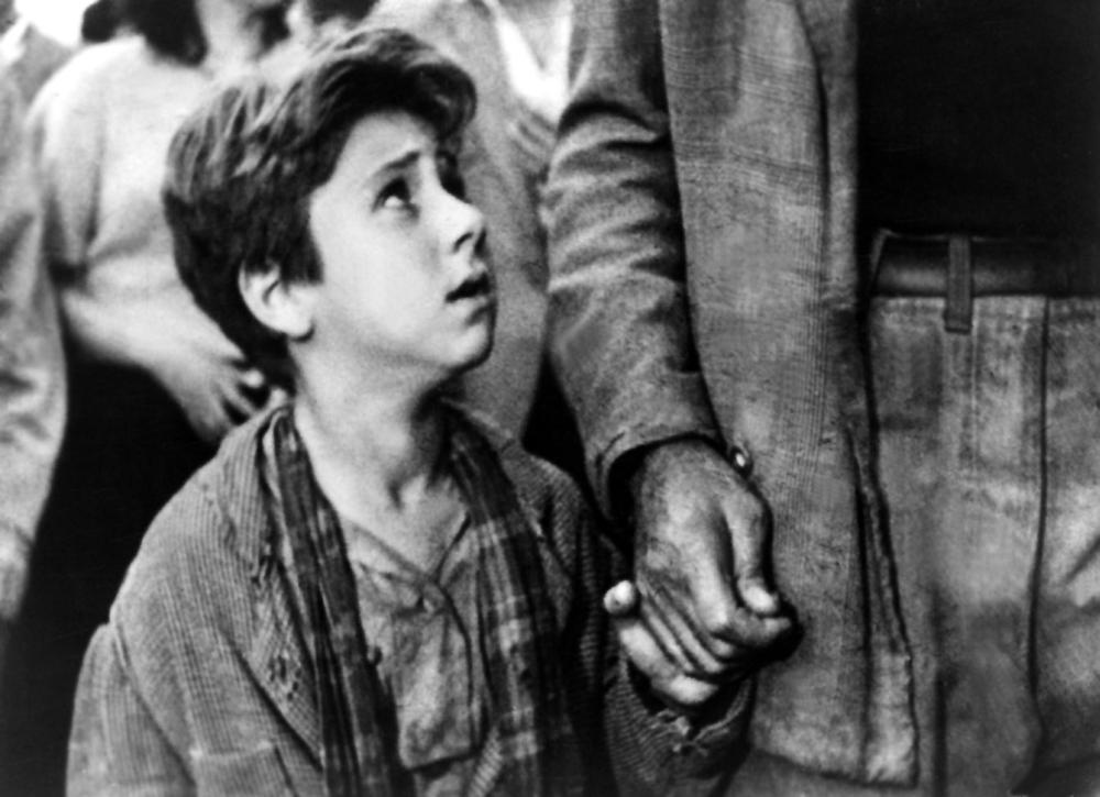 THE BICYCLE THIEF, (aka LADRI DI BICICLETTE, aka BICYCLE THIEVES), Enzo Staiola, 1948.