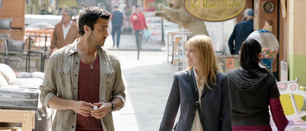 PULLING STRINGS, from left: Jaime Camil, Laura Ramsey, 2013. ©Lionsgate
