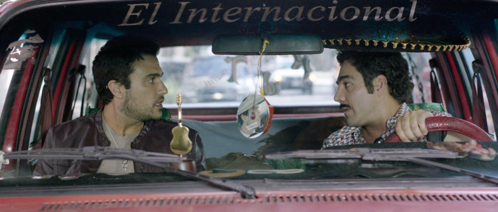PULLING STRINGS, from left: Jaime Camil, Omar Chaparro, 2013. ©Lionsgate