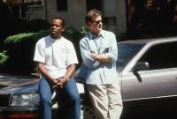 GRAND CANYON, Danny Glover, Kevin Kline, 1991, leaning on car  TM and Copyright (c) 20th Century Fox Film Corp. All rights reserved.
