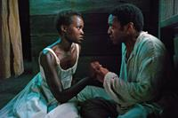 12 YEARS A SLAVE, l-r: Lupita Nyong'o, Chiwetel Ejiofor, 2013, ph: Francois Duhamel/TM and Copyright ©Fox Searchlight Pictures. All rights reserved.