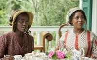 12 YEARS A SLAVE, l-r: Lupita Nyong'o, Alfre Woodard, 2013, ph: Jaap Buitendijk/TM and Copyright ©Fox Searchlight Pictures. All rights reserved.