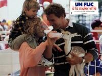 KINDERGARTEN COP, Penelope Ann Miller, Arnold Schwarzenegger, 1990, feeding the faun