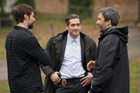 PRISONERS, from left: Hugh Jackman, Jake Gyllenhaal, director Denis Villeneuve, on set, 2013. ph: Wilson Webb/©Warner Bros.