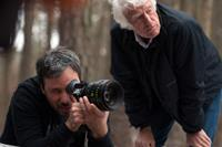 PRISONERS, from left: director Denis Villeneuve, cinematographer Roger Deakins, on set, 2013. ph: Wilson Webb/©Warner Bros.