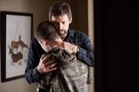 PRISONERS, Hugh Jackman (back), Dylan Minnette, 2013. ph: Wilson Webb/©Warner Bros.