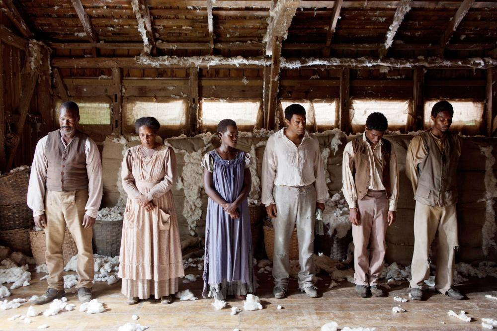 12 YEARS A SLAVE, Lupita Nyong'o (blue dress), Chiwetel Ejiofor (right of center), 2013. ph: Francois Duhamel/TM and Copyright ©Fox Searchlight Pictures. All rights reserved.