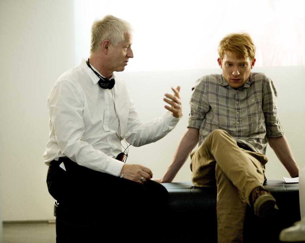 ABOUT TIME, from left: director Richard Curtis, Domhnall Gleeson, on set, 2013. ph: Murray Close/©Universal