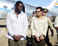MANDELA: LONG WALK TO FREEDOM, from left: Idris Elba as Nelson Mandela, Riaad Moosa, 2013. ph: Keith Bernstein/©Weinstein Company